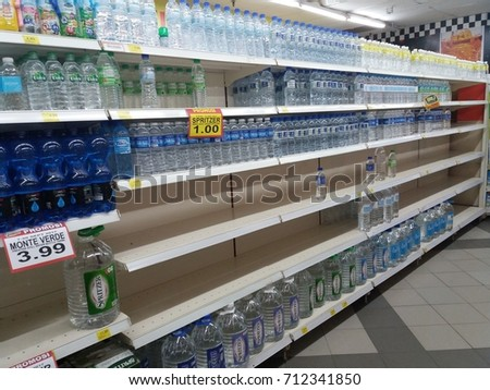 Kuala Lumpur , Malaysia - 9 September 2017 : Mineral water bottle's display on the shelf in supermarket