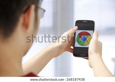 Kuala Lumpur,Malaysia 9th April 2015,Closeup photo of Google Chrome icon on mobile phone screen - stock photo