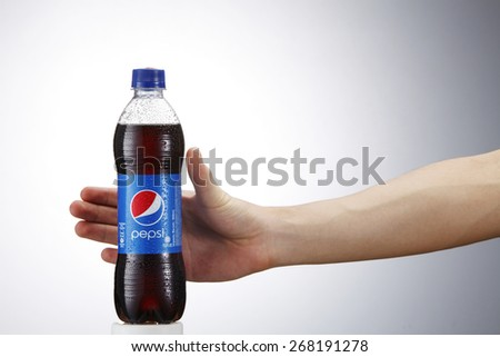 Kuala Lumpur,Malaysia 9th April 2015,Reaching a can of Pepsi . Pepsi is a carbonated soft drink produced and manufactured by PepsiCo Inc. an American multinational food and beverage company. - stock photo
