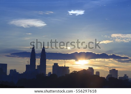 KUALA LUMPUR, MALAYSIA, 13th January 2016: A Silhouette photo of Kuala Lumpur City Center (KLCC) and buildings in Kuala Lumpur, Malaysia during golden hour time with blue yellowish sky