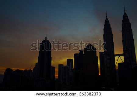 KUALA LUMPUR, MALAYSIA - 17TH JANUARY 2016; Silhouette of Kuala Lumpur city during sunrise. Its modern skyline is dominated by the 451m-tall KLCC, a pair of glass-and-steel-clad skyscrapers.