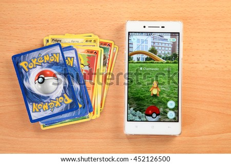 Kuala Lumpur,Malaysia 13th July 2016 , from pokemon card game to Pokemon Go, a free-to-play augmented reality mobile game developed by Niantic for iOS and Android devices. - stock photo