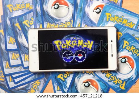 Kuala Lumpur,Malaysia 23th July 2016, smartphone with pokemon go logo on the screen on top of pokemon card - stock photo