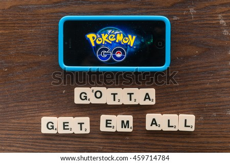 Kuala Lumpur,Malaysia 25th July 2016, smartphone with pokemon go logo on the screen with catch phrase words.
