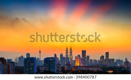 KUALA LUMPUR, MALAYSIA - 29TH MARCH 2016; Kuala Lumpur skyline in dreamy and blurry look like during a sunset with haze condition. Image contain vibrant color and blurry effect.
