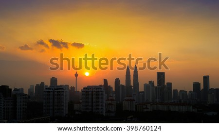 KUALA LUMPUR, MALAYSIA - 29TH MARCH 2016; View silhouette of Kuala Lumpur skyline during hazy sunset on MARCH 29, 2016.
