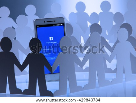 Kuala Lumpur Malaysia, 28th may 2016, of people man surrounding  at social network facebook sign in page on smartphone - stock photo