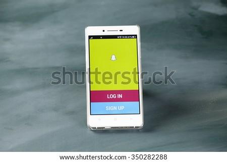 kuala lumpur-malaysia, 16th november 2015,smart phone display with snap chat log in page - stock photo