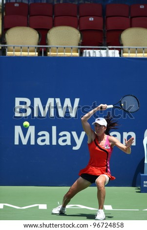 KUALA LUMPUR, MARCH 4: Jelena Jankovic returns ball during a semi-finals match against Petra Martic at the BMW Malaysian Open on March 4,2012 in Kuala Lumpur. Petra Martic win [6-7(5-7),7-5,7-6 (7-5)] - stock photo