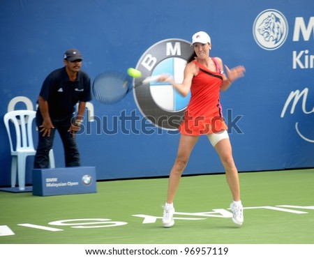 KUALA LUMPUR-MARCH 4: Jelena Jankovic returns ball during a semi-finals match against Petra Martic at the BMW Malaysian Open on March 4, 2012 in Kuala Lumpur.Petra Martic win [6-7(5-7),7-5,7-6 (7-5)] - stock photo