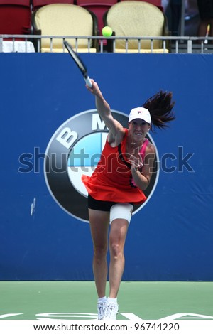KUALA LUMPUR - MARCH 4: Jelena Jankovic serves during a semi-finals match against Petra Martic at the BMW Malaysian Open on March 3,2012 in Kuala Lumpur, Malaysia. Petra Martic won [6-7(5-7),7-5,7-6 (7-5)] - stock photo