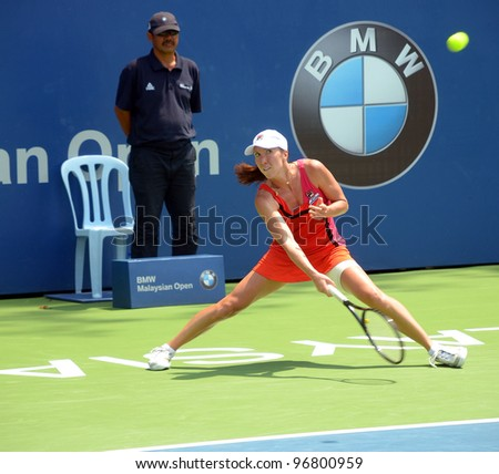 KUALA LUMPUR- MARCH 4: Jelena Jankovic serves during a semi-finals match against Petra Martic at the BMW Malaysian Open on March 4, 2012 in Kuala Lumpur, Malaysia. Petra Martic win [6-7(5-7),7-5,7-6 (7-5)] - stock photo