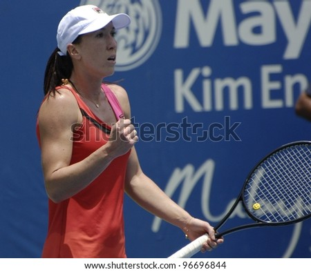 KUALA LUMPUR - MARCH 4: Jelena Jankovic (SRB) is defeated by Petra Martic(CRO) at their semifinal match with score 7-6, 5-7, 6-7 during BMW Malaysian Open in Kuala Lumpur, Malaysia on March 4, 2012. - stock photo