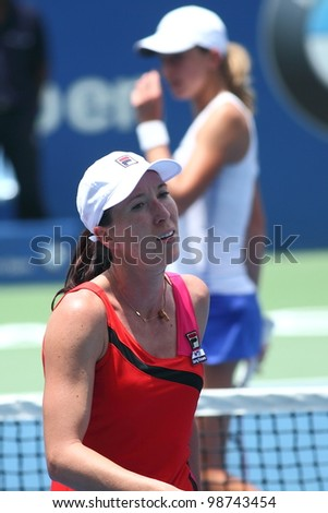 KUALA LUMPUR-MARCH 4: Jelena Jankovic(SRB) react in frustration while compete against Petra Martic(CRO) during BMW Malaysia Open on March 4, 2012 in Kuala Lumpur, Malaysia.Martic won 6:7(5),7:5,7:6(5) - stock photo