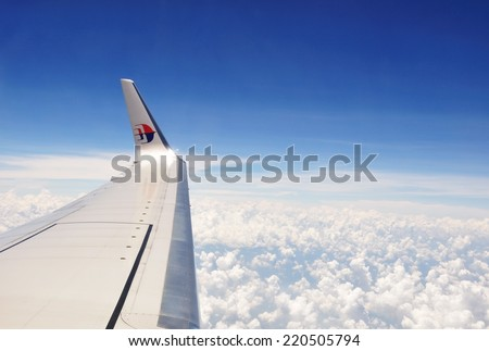 KUALA LUMPUR - MARCH 23: Malaysia Airlines Boeing 737 in the air, flying from Kuala Lumpur to Kota Kinabalu, Sabah on March 23, 2013. Malaysia Airlines is a government-owned flag carrier of Malaysia.  - stock photo
