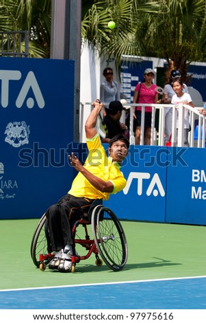 KUALA LUMPUR-MARCH 4: Malaysia Olympic Wheelchair players Abu Samah Borhan serves during a skilled performance show at the BMW Malaysian Open on March 4, 2012 in Kuala Lumpur, Malaysia.