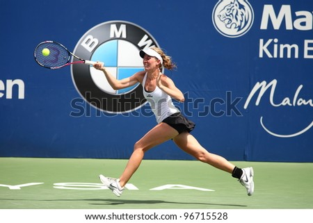 KUALA LUMPUR,MARCH 3: Olivia Rogowska return a ball during a single quarter-finals match against Eleni Daniilidou at the BMW Malaysian Open on March 3,2012 in Kuala Lumpur.Daniilidou win (6-2,3-6,6-2)