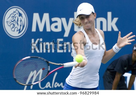 KUALA LUMPUR - MARCH 4: Petra Martic(CRO) returns ball to Jelena Jankovic (SRB) at semi final match, Martic win with 7-6, 5-7, 6-7 during BMW Malaysian Open in Kuala Lumpur, Malaysia on March 4, 2012 - stock photo