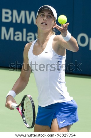KUALA LUMPUR - MARCH 4: Petra Martic(CRO) serves ball to Jelena Jankovic (SRB) at semi final match, Martic win with 7-6, 5-7, 6-7 during BMW Malaysian Open in Kuala Lumpur, Malaysia on March 4, 2012 - stock photo