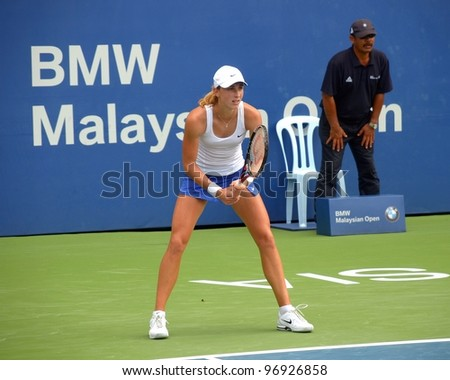 KUALA LUMPUR -MARCH 4: Petra Martic returns ball during a semi-finals match against Jelena Jankovic at the BMW Malaysian Open on March 4,2012 in Kuala Lumpur.Petra Martic win [6-7(5-7),7-5,7-6 (7-5)] - stock photo