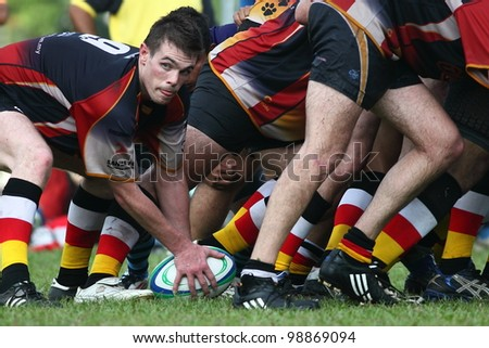 KUALA LUMPUR - MARCH 29: Unidentified RSC Dog player pick the ball after scrum during the NICC final rugby match against SSTMI Bandar Penawar on March 29,2012 in Kuala Lumpur,Malaysia. SSTMI won 24-15 - stock photo