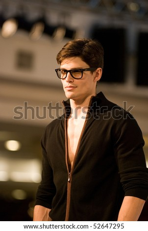 KUALA LUMPUR - MAY 8: A model poses an outfit creation by Valentino Rudy during Licence To Styles fashion show on May 8,2010 in Kuala Lumpur Malaysia - stock photo