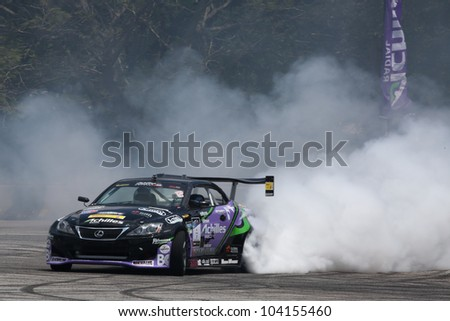KUALA LUMPUR - MAY 19: Japan's Daigo Saito in a Lexus SC430 burns up some rubber in a performance during the Formula Drift 2012 Asia Round 1 on May 19, 2012 in Speedcity, Kuala Lumpur, Malaysia. - stock photo
