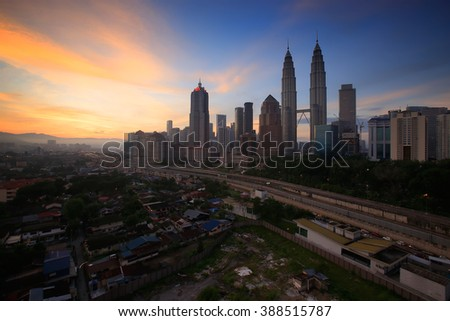 KUALA LUMPUR May 15 2015 : Petronas Twin Towers at sunrise with vibrant sky on 15 May 2016 in Kuala Lumpur. Petronas Twin Towers also known as KLCC is the tallest building in Malaysia.