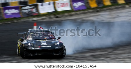 KUALA LUMPUR - MAY 19: Thailand's Nattawoot driving a Nissan RX-7 makes a practice run during the Formula Drift 2012 Asia Round 1 on May 19, 2012 in Speedcity, Kuala Lumpur, Malaysia. - stock photo