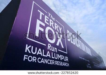 KUALA LUMPUR - NOV 2: Board showing Terry Fox Run on November 2, 2014 at KL Malaysia. The Terry Fox Run is a non-competitive charity event take place every year from all over the world - stock photo