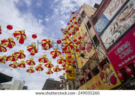 KUALA LUMPUR - NOV 16: Old buildings along the bustling Chinatown street on November 16, 2014 in Kuala Lumpur. The city's ethnic Chinese began settling Chinatown Petaling Street area circa 1850s. - stock photo