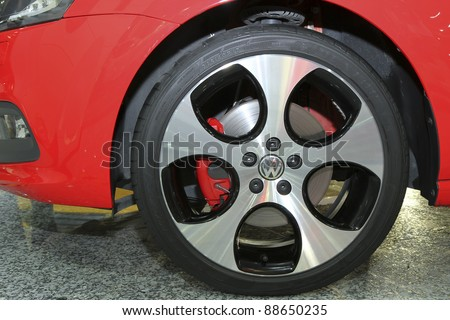 KUALA LUMPUR - NOV 12: Rims of the VW Polo GTI on display at the Car Of The Year Auto Show on November 12, 2011 in Kuala Lumpur, Malaysia. The twin-charged 1.4 litre TSI with 7 speed DSG transmission. - stock photo