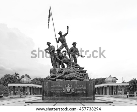 KUALA LUMPUR - NOV 11, 2013: The Bronze statue of Malaysia National Monument in Jalan Parlimen, Kuala Lumpur. The 15 meter statues are the world's tallest freestanding group of bronze sculptures.