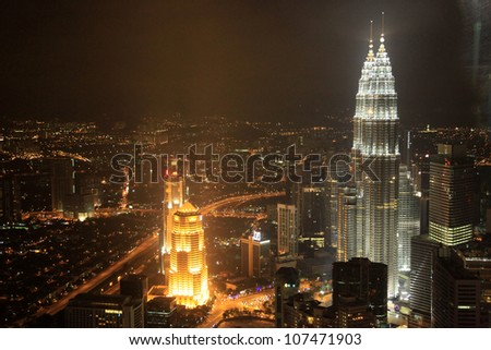 KUALA LUMPUR - NOV 26: The Petronas Twin Towers on November 26, 2011, in Kuala Lumpur, Malaysia are the world's tallest twin tower. The skyscraper height is 451.9m