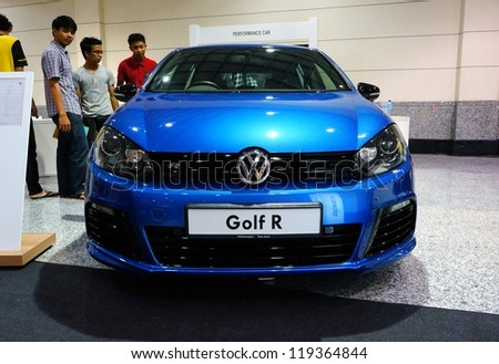 KUALA LUMPUR - NOV 11: VW Golf R on display at the Car Of The Year Auto Show on November 11 2012 in Kuala Lumpur, Malaysia. VW Golf R; 2.0-litre turbocharged four-cylinder with DSG transmission, 256hp - stock photo