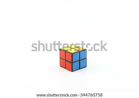 KUALA LUMPUR- November 28, 2015: Rubik's cube on a white background. Rubik's Cube invented by a Hungarian architect Erno Rubik in 1974.