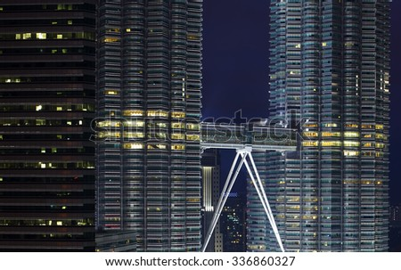 KUALA LUMPUR - OCT 31 : Close up view of the sky bridge of The Petronas Twin Towers on Oct 31, 2015, in Kuala Lumpur, Malaysia has the world's tallest twin towers. The skyscraper height is 451.9m