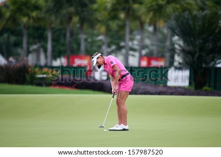 KUALA LUMPUR - OCTOBER 12:Brittany Lang of USA putts on the 2nd hole green of the KLGCC course on Day 3 of the Sime Darby LPGA on October 12, 2013 in Kuala Lumpur, Malaysia. - stock photo