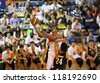KUALA LUMPUR - OCTOBER 28: Dragons' Satyaseelan (white) rolls in the ball to score against Firehorse team in a Malaysia National Basketball League match on October 28, 2012 in Kuala Lumpur, Malaysia. - stock photo