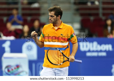KUALA LUMPUR - SEP 27:Albert Ramos of Spain reacts after a shot played at the ATP Tour Malaysian Open 2012 on September 27, 2012 at the Putra Stadium, Kuala Lumpur, Malaysia. He lost to Kei Nishikori.