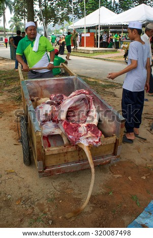 KUALA LUMPUR-SEP 24: An unidentified Malaysian Muslim gather meat to distribute to the poor and homeless during Eid Al-Adha Al Mubarak,the Feast of Sacrifice September 24 2015 in Kuala Lumpur Malaysia - stock photo