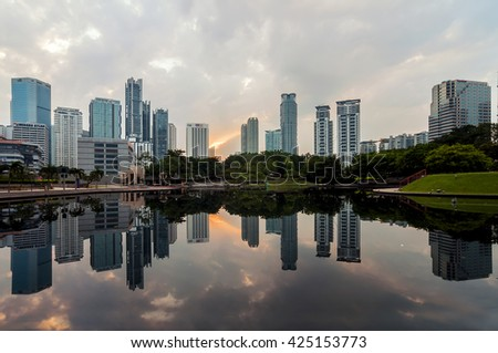 KUALA LUMPUR - 2 Sep 2016: Part of Kuala Lumpur skyline with line of corporate building with reflection from Symphony Lake KLCC