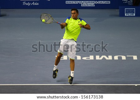 KUALA LUMPUR - SEPTEMBER 25: Nicholas Almagro (Spain) hits a forehand return in a first round tennis match at the Malaysia Open 2013 played at the Putra Stadium, Malaysia on September 25, 2013.