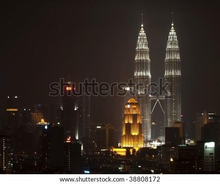 Kuala Lumpur skyline showing skyscrapers and twin towers - stock photo