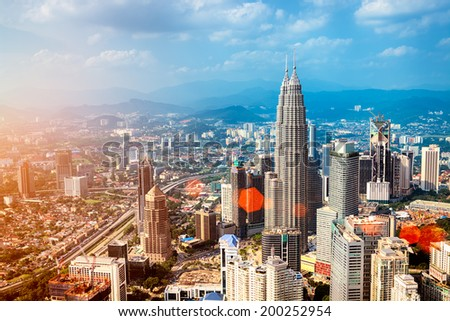 Kuala Lumpur skyline with the Petronas Towers and other skyscrapers. (Malaysia.) - stock photo