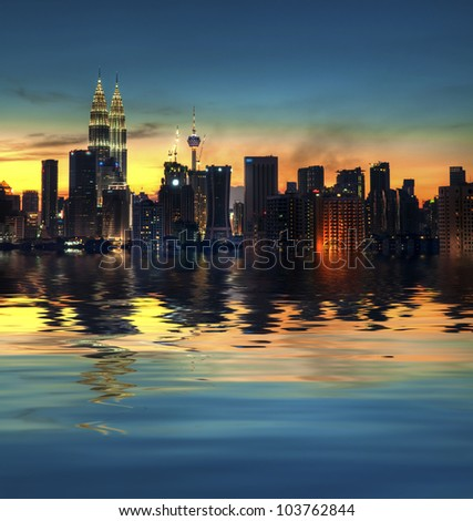 Kuala Lumpur, the capital city of Malaysia, view with water reflection - stock photo