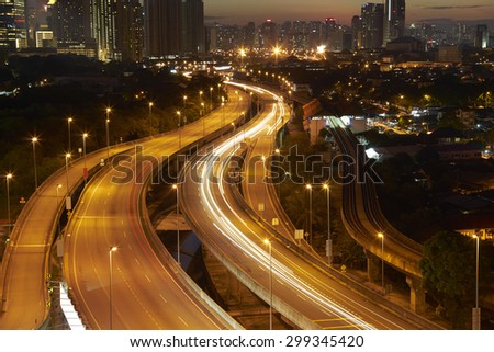 Kuala Lumpur  with stunning light trail from the  busy  highway traffic. - stock photo