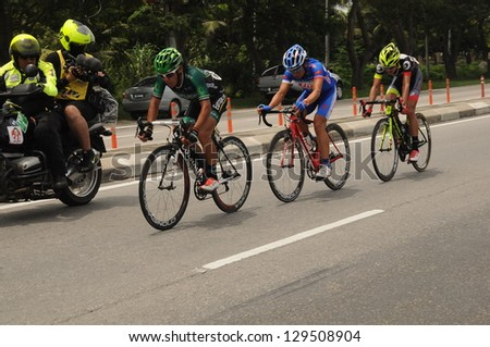 KUALA SELANGOR, MALAYSIA - FEBRUARY 24: A group of cyclist participates in Stage 4 of the Tapah - Kapar for the 2013 Le Tour de Langkawi on Feb. 24, 2013 in Kuala Selangor, Malaysia - stock photo