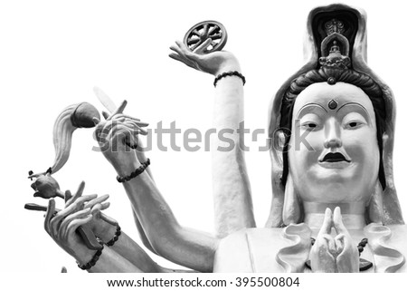 Kuan Yin. goddess of mercy showing a lot of hands sitting on lotus statue