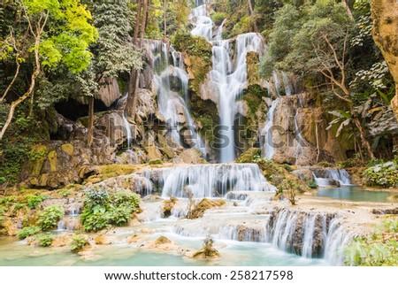 Kuang Si Falls or known as Tat Kuang Si Waterfalls in Luang Prabang, Laos - stock photo